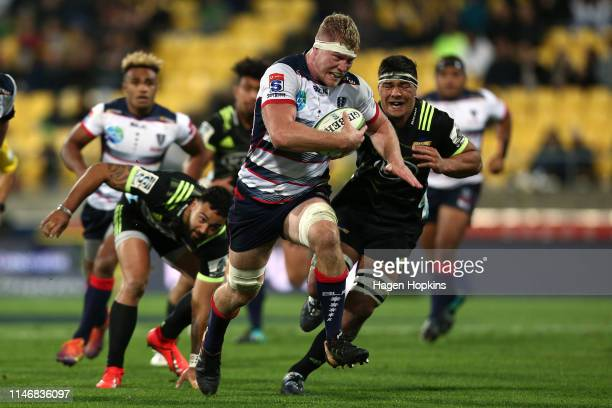 Matt Philip of the Rebels makes a break during the round 12 Super Rugby match between the Hurricanes and Rebels at Westpac Stadium on May 04, 2019 in...