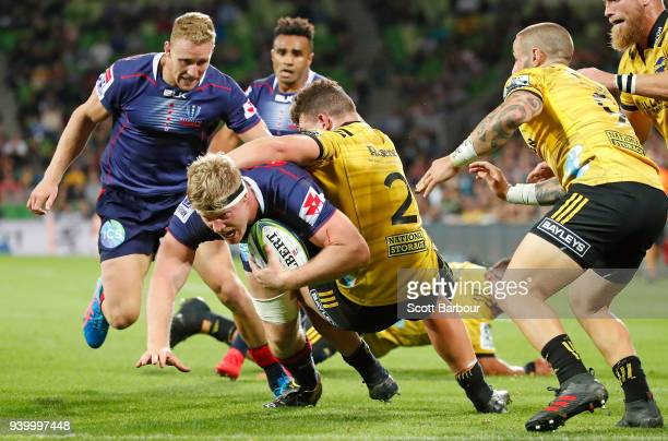 Matt Philip of the Rebels scores a try during the round seven Super Rugby match between the Rebels and the Hurricanes at AAMI Park on March 30 2018...