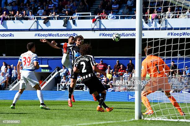 Matt Philips of QPR scores their first goal under pressure from Fabricio Coloccini of Newcastle United during the Barclays Premier League match...