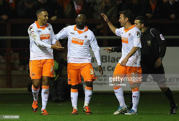 Matt Phillips of Blackpool celebrates with Angel Martinez and Lomana Lua Lua after scoring his third goal during the FA Cup sponsored by Budweiser...