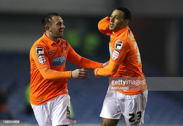 Matt Phillips of Blackpool celebrates with Neil Eardley after scoring the opening goal during the FA Cup Fourth Round Replay match between Sheffield...