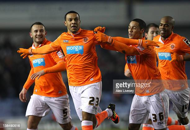 Matt Phillips of Blackpool celebrates with team mates after scoring the opening goal during the FA Cup Fourth Round Replay match between Sheffield...