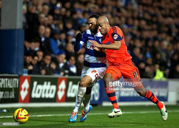 Matt Phillips of QPR battles for the ball with Bolton's Alex Baptiste during the Sky Bet Championship match between Queens Park Rangers and Bolton...