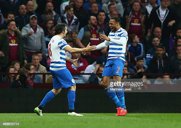 Matt Phillips of QPR cekebrates with Joey Barton as he scores their first goal with a header during the Barclays Premier League match between Aston...