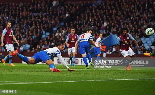 Matt Phillips of QPR scores their first goal with a header during the Barclays Premier League match between Aston Villa and Queens Park Rangers at...