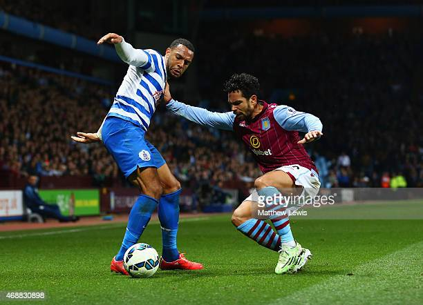 Matt Phillips of QPR takes on Kieran Richardson of Aston Villa during the Barclays Premier League match between Aston Villa and Queens Park Rangers...