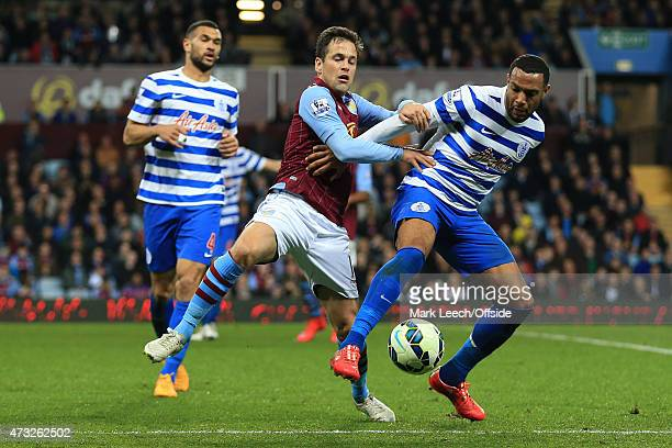 Matt Phillips of QPR tangles with Joe Cole of Aston Villa as Steven Caulker of QPR looks on during the Barclays Premier League match between Aston...