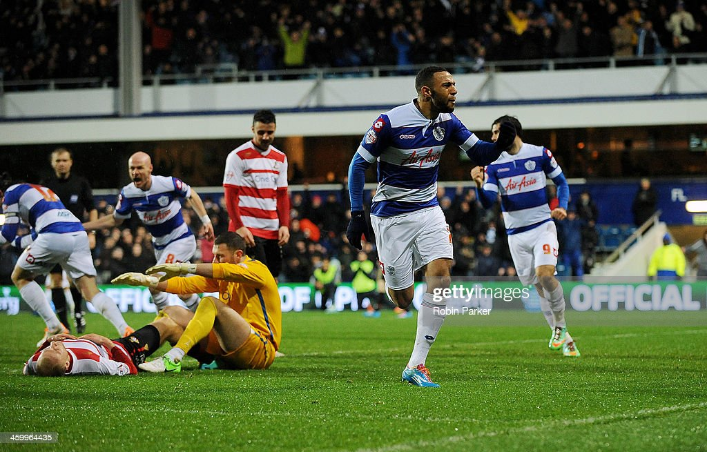 Matt Phillips of Queens Park Rangers celebrates scoring 1st goal as a dejected Ross Turnbull of Doncaster Rovers sits on the ground during the Sky Bet Championship match between Queens Park Rangers and Doncaster Rovers at Loftus Road on January 1, 2014 in London, England,