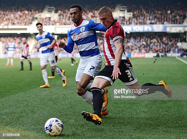 Matt Phillips of Queens Park Rangers chases down Jake Bidwell of Brentford during the Sky Bet Championship match between Queens Park Rangers and...