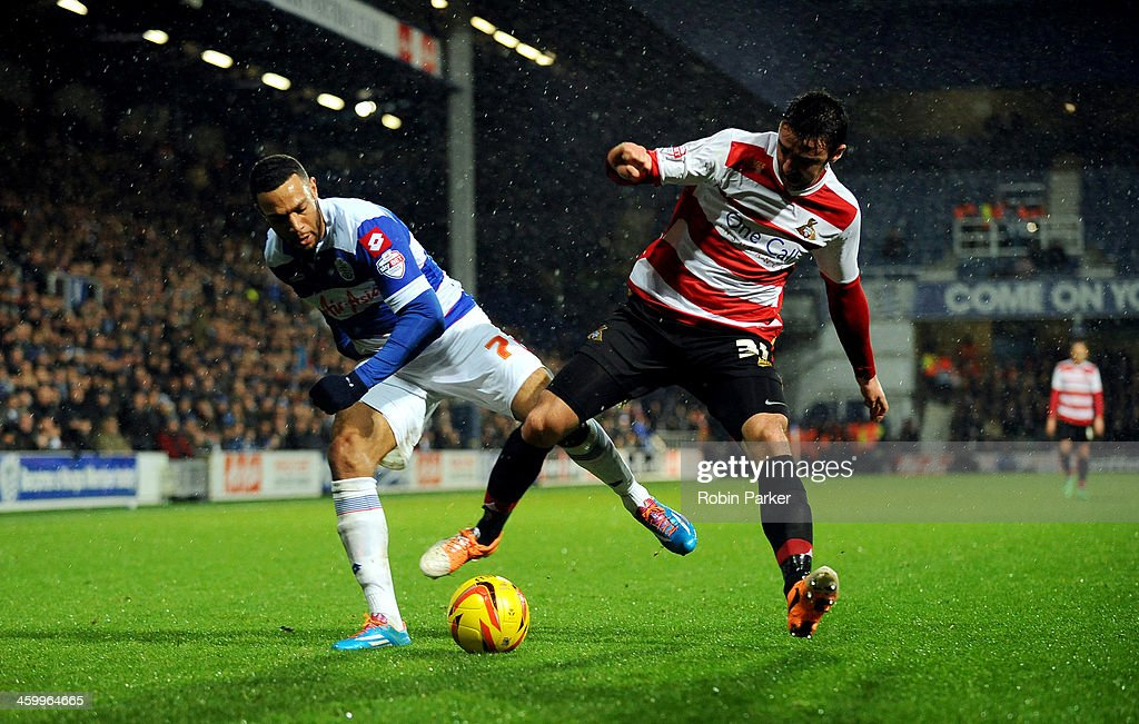 Matt Phillips of Queens Park Rangers is challenged by Enda Stevens of Doncaster Rovers during the Sky Bet Championship match between Queens Park Rangers and Doncaster Rovers at Loftus Road on January 1, 2014 in London, England,