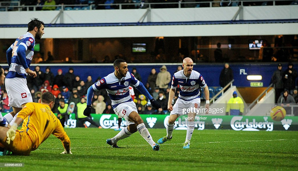 Matt Phillips of Queens Park Rangers scores 1st goal as he's challenged by Ross Turnbull of Doncaster Rovers during the Sky Bet Championship match between Queens Park Rangers and Doncaster Rovers at Loftus Road on January 1, 2014 in London, England,