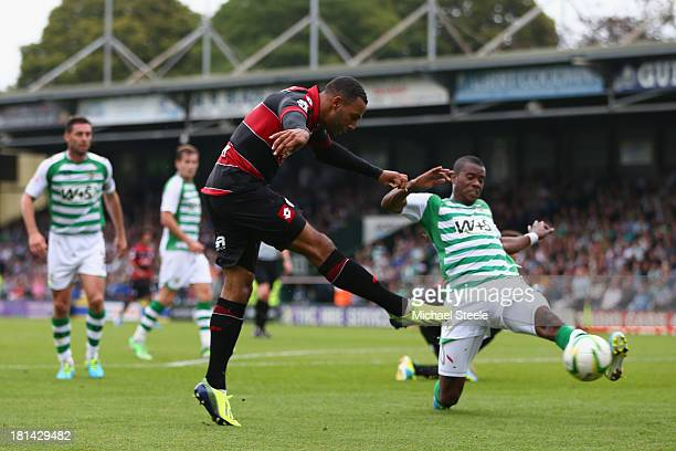 Matt Phillips of Queens Park Rangers shoots as Joel Grant of Yeovil Town blocks during the Sky Bet Championship match between Yeovil Town and Queens...