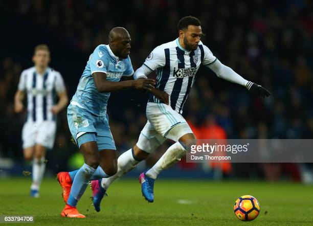 Matt Phillips of West Bromwich Albion and Bruno Martins Indi of Stoke City compete for the ball during the Premier League match between West Bromwich...