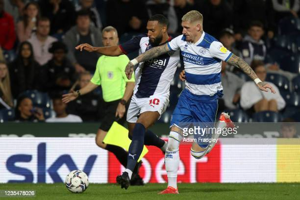 Matt Phillips of West Bromwich Albion and Jordy De Wijs of Queens Park Rangers during the Sky Bet Championship match between West Bromwich Albion and...