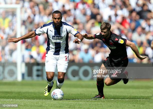 Matt Phillips of West Bromwich Albion and Luke Murphy of Bolton Wanderers during the Sky Bet Championship match between West Bromwich Albion and...