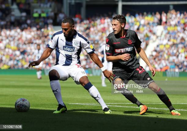 Matt Phillips of West Bromwich Albion and Will Buckley of Bolton Wanderers during the Sky Bet Championship match between West Bromwich Albion and...