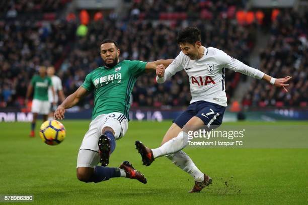Matt Phillips of West Bromwich Albion attempts to block HeungMin Son of Tottenham Hotspur shot during the Premier League match between Tottenham...