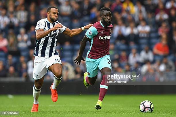 Matt Phillips of West Bromwich Albion battles with Arthur Masuaku of West Ham United during the Premier League match between West Bromwich Albion and...