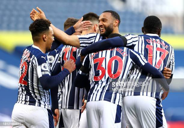 Matt Phillips of West Bromwich Albion celebrates after scoring their sides second goal with team mate Matheus Pereira during the Premier League match...