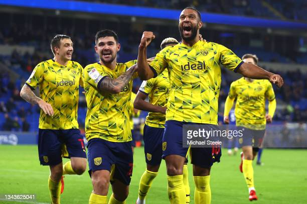 Matt Phillips of West Bromwich Albion celebrates with team mate Alex Mowatt after scoring their sides fourth goal during the Sky Bet Championship...