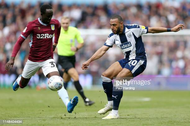 Matt Phillips of West Bromwich Albion challenges for the ball with Albert Adomah of Aston Villa during the Sky Bet Championship Playoff semi final...