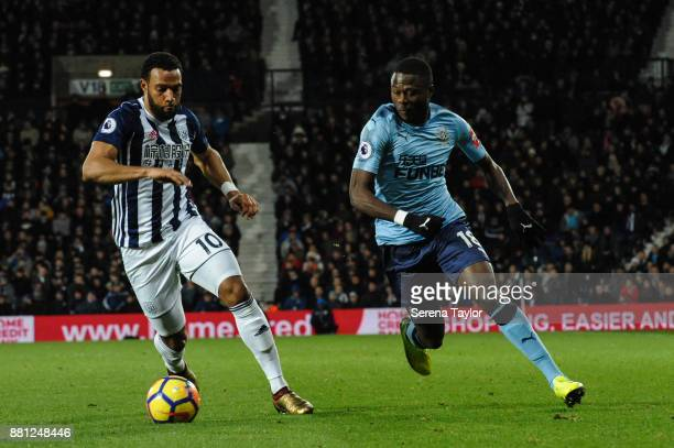Matt Phillips of West Bromwich Albion controls the ball whilst Chancel Mbemba of Newcastle United is in pursuit during the Premier League match...