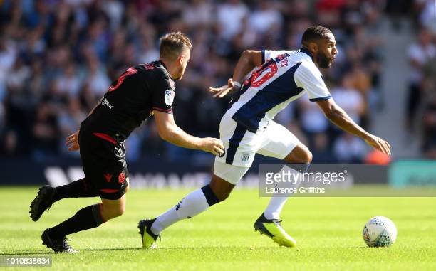 Matt Phillips of West Bromwich Albion goes past Andrew Taylor of Bolton Wanderers during the Sky Bet Championship match between West Bromwich Albion...