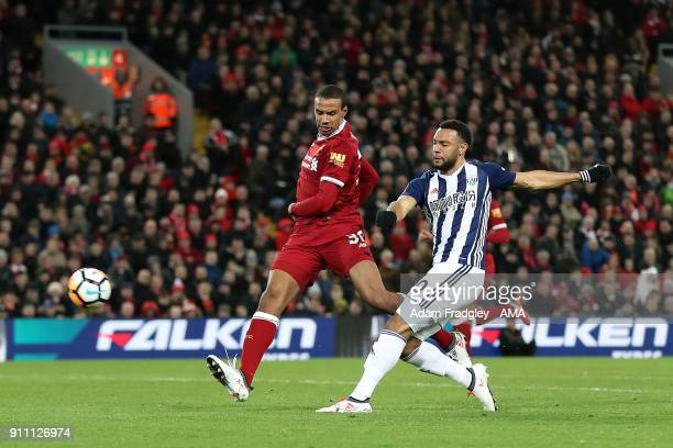 Matt Phillips of West Bromwich Albion has a shot at goal that goes over the bar as he is marshalled by Joel Matip of Liverpool during the The...