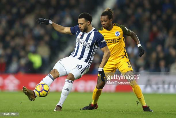 Matt Phillips of West Bromwich Albion is challenged by Gaetan Bong of Brighton and Hove Albion during the Premier League match between West Bromwich...