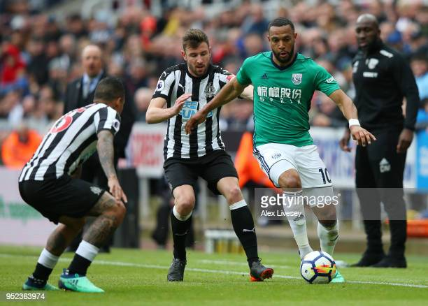 Matt Phillips of West Bromwich Albion is challenged by Paul Dummett of Newcastle United during the Premier League match between Newcastle United and...