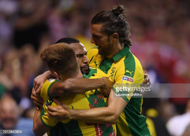 Matt Phillips of West Bromwich Albion is congratulated by Harvey Barnes and Jay Rodriguez after scoring the equalising goal during the Sky Bet...