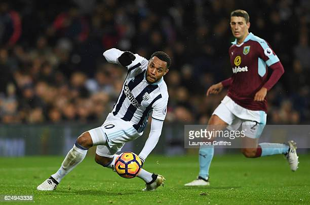 Matt Phillips of West Bromwich Albion is watched by Matthew Lowton of Burnley during the Premier League match between West Bromwich Albion and...