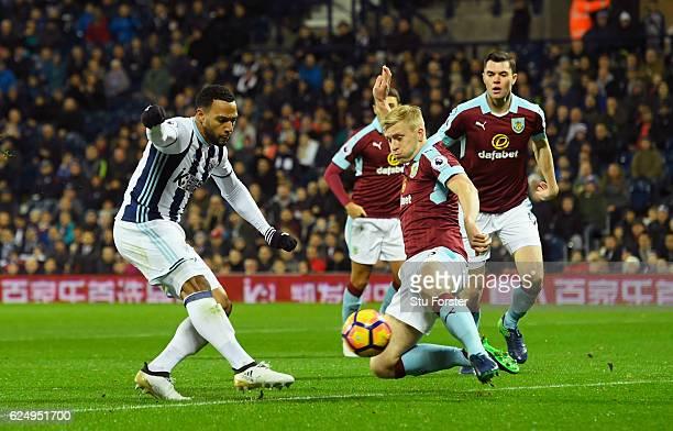Matt Phillips of West Bromwich Albion shootd past Ben Mee of Burnley as he scores their first goal during the Premier League match between West...
