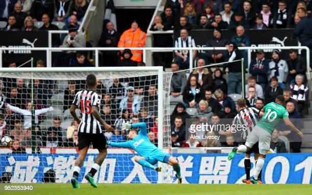 Matt Phillips of West Bromwich Albion shoots and scores his side's first goal during the Premier League match between Newcastle United and West...