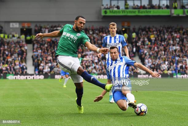 Matt Phillips of West Bromwich Albion shoots as Markus Suttner of Brighton and Hove Albion attempts to block during the Premier League match between...