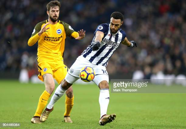 Matt Phillips of West Bromwich Albion shoots while under pressure from Davy Propper of Brighton and Hove Albion during the Premier League match...