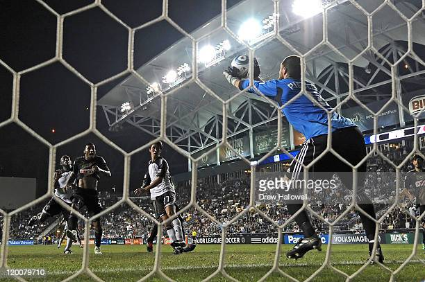 Matt Pickens of the Colorado Rapids makes a save at the end of extra time during the game against the Philadelphia Union at PPL Park on July 29, 2011...
