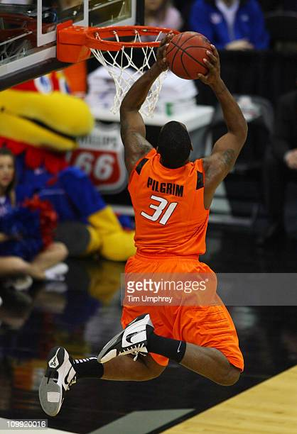 Matt Pilgrim of the Oklahoma State Cowboys goes up for a dunk in a game against the Kansas Jayhawks during the quarterfinals of the 2011 Phillips 66...