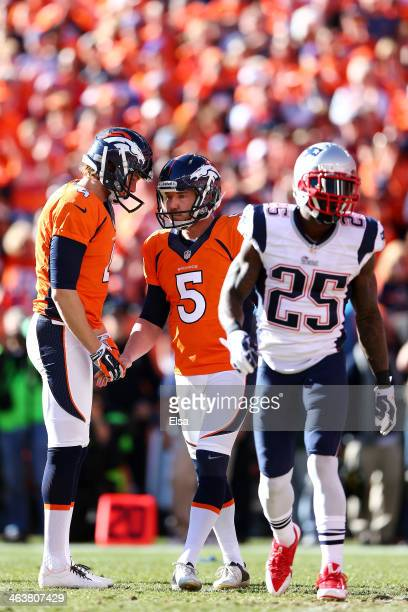 Matt Prater celebrates his first quarter field goal with Britton Colquitt of the Denver Broncos as Kyle Arrington of the New England Patriots reacts...