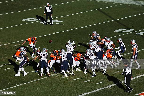 Matt Prater of the Denver Broncos kicks an extra point in the third quarter against the New England Patriots during the AFC Championship game at...