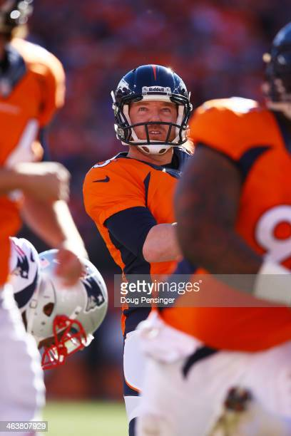 Matt Prater of the Denver Broncos reacts to his first quarter field goal against the New England Patriots during the AFC Championship game at Sports...