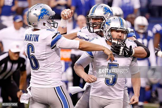 Matt Prater of the Detroit Lions celebrates with teammates after kicking the game winning field goal in the fourth quarter of the game against the...