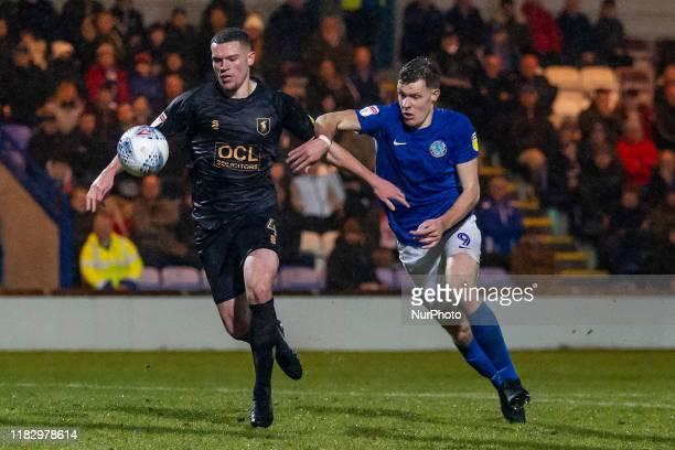 Matt Preston of Mansfield Town battling with Joe Ironside of Macclesfield Town during the Sky Bet League 2 match between Macclesfield Town and...