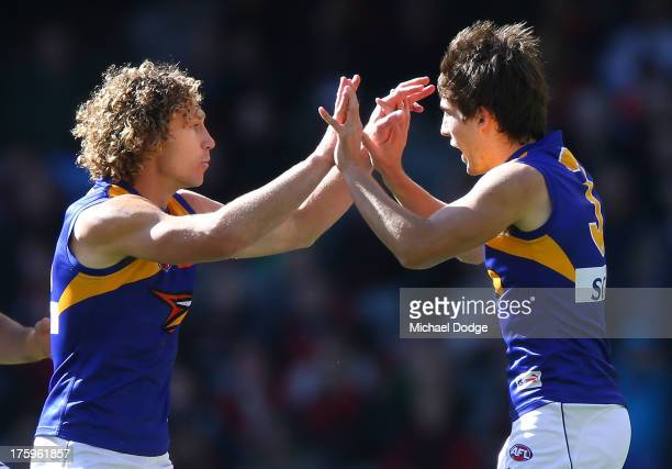 Matt Priddis and Andrew Gaff of the Eagles celebrate a goal during the round 20 AFL match between the Essendon Bombers and the West Coast Eagles at...