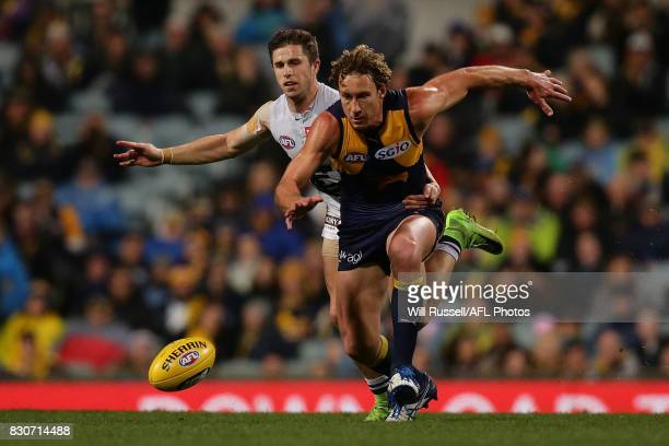 Matt Priddis of the Eagles and Marc Murphy of the Blues chase the ball during the round 21 AFL match between the West Coast Eagles and the Carlton...