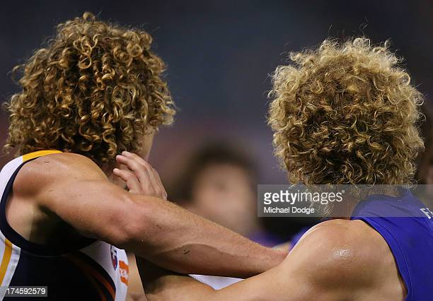 Matt Priddis of the Eagles and Mitch Wallis of the Bulldogs show off the same hair style during the round 18 AFL match between the Western Bulldogs...