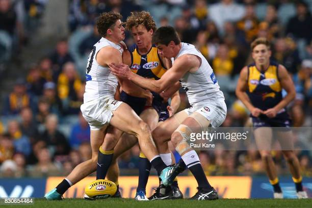 Matt Priddis of the Eagles gets tackled by Charlie Curnow and Matthew Kreuzer of the Blues during the round 21 AFL match between the West Coast...