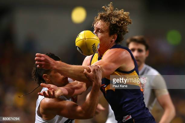 Matt Priddis of the Eagles gets tackled by Sam Petrevski-Seton of the Blues during the round 21 AFL match between the West Coast Eagles and the...