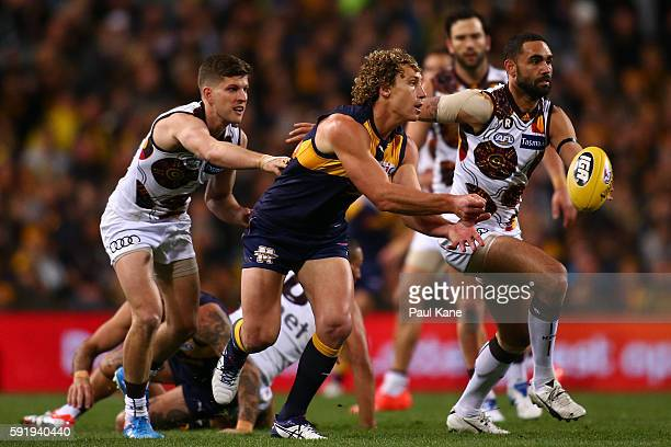 Matt Priddis of the Eagles handballs during the round 22 AFL match between the West Coast Eagles and the Hawthorn Hawks at Domain Stadium on August...