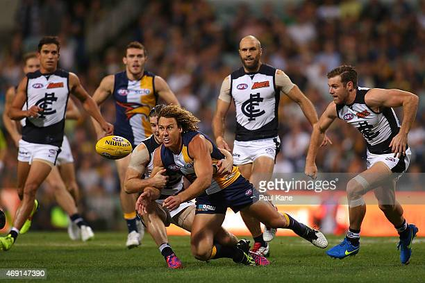 Matt Priddis of the Eagles handballs during the round two AFL match between the West Coast Eagles and the Carlton Blues at Domain Stadium on April...